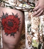 alice carrier big red poppy tattoo