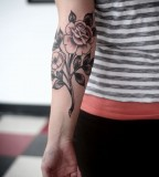 alice carrier rose tattoo on inside arm