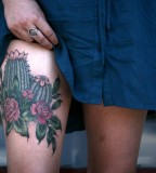 alice carrier tattoo cactus on leg