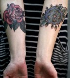 alice carrier tattoo red and blue flowers on inside arms