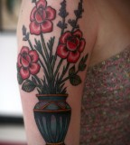 alice carrier tattoo vase of flowers on arm