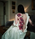 back tattoo design for women elegant red flowers