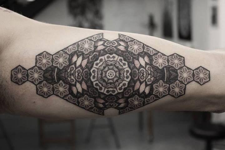 kenji alucky tattoo ornament on upper arm