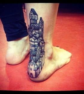liam sparkes tattoo blue buildings on back leg