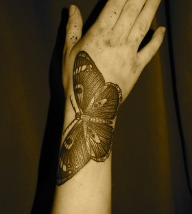 liam sparkes tattoo butterfly on arm and hand