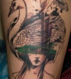 marta lipinski woman with swan  hat tattoo