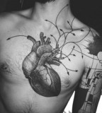 modern tattoo anatomic heart with arrows
