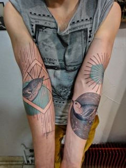 modern tattoo birds on arms
