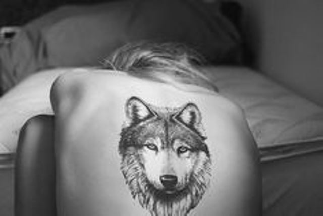 modern tattoo wolf head on back