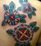 virginia elwood tattoo three mandala flowers on back shoulder