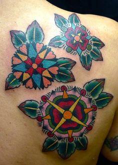 virginia elwood tattoo three mandala flowers on back shoulder