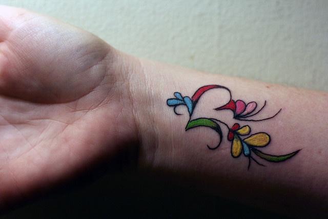 wrist tattoo colorful work