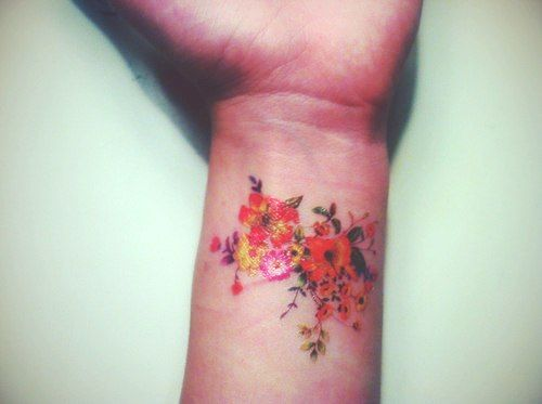 wrist tattoo floral work