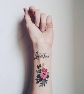 wrist tattoo flowers joie de vivre