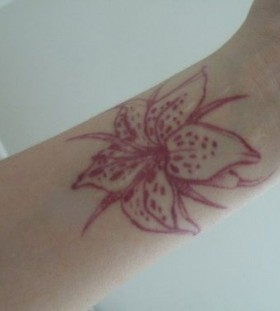 wrist tattoo red ink flower