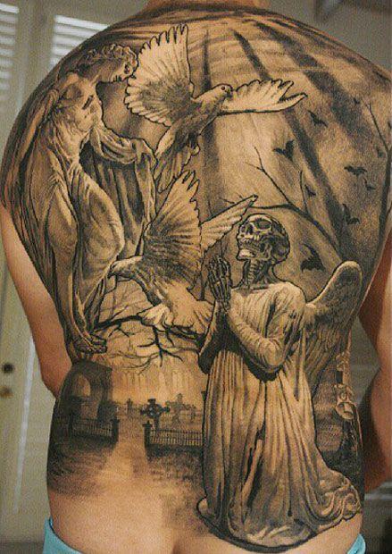 Amaizing skull religious tattoo