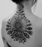 Black flowers back tattoo