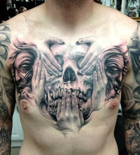 Adorable skull and hand chest tattoo