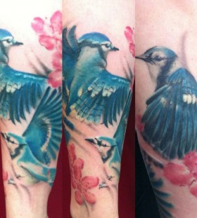 Amaizing blue bird tattoo by Mel Wink