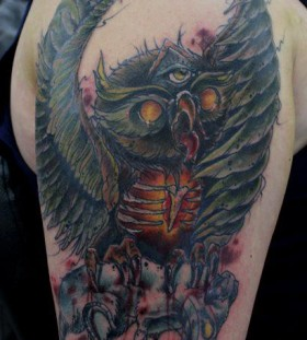 Angry owl tattoo by Mel Wink
