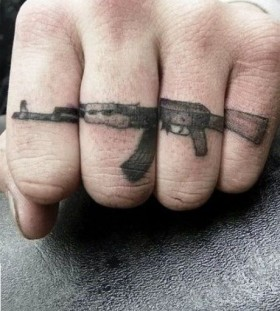 Awesome fingers guns tattoo