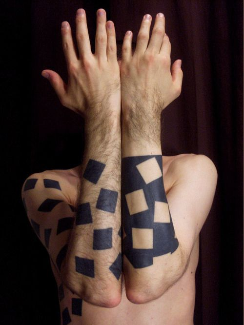 Black and white puzzle tattoo