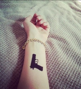 Black arm guns tattoo