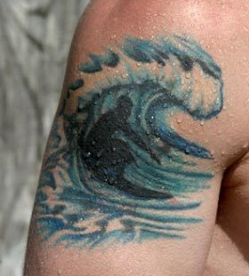Blue surfing sport tattoo