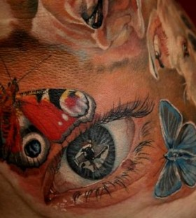 Butterflies and eye photorealistic tattoo