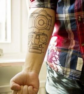 Camera details photorealistic tattoo