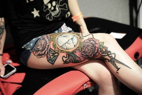 Colorful legs clock tattoo