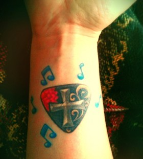 Criss  music tattoo
