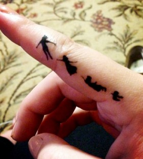 Finger Peter Pan tattoo