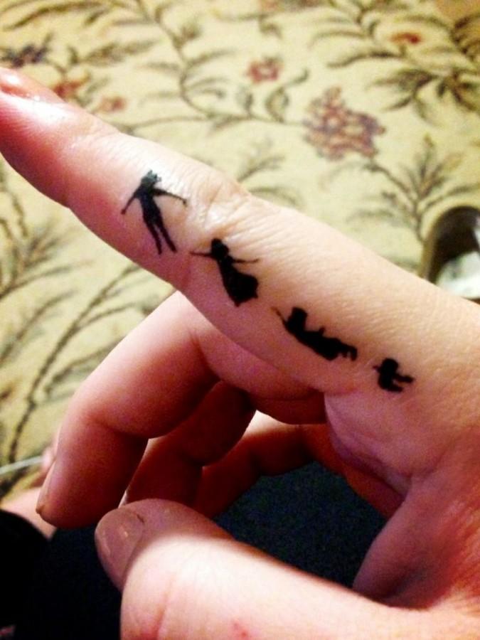 Finger Peter Pan tattoo