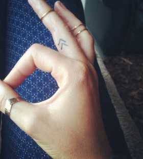 Fingers symbols tattoo