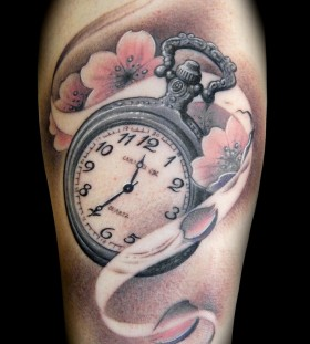 Flowers and clock tattoo