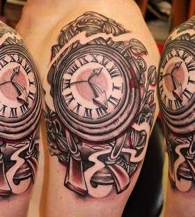 Gorgeous shoulder clock tattoo