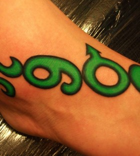 Green symbols tattoo
