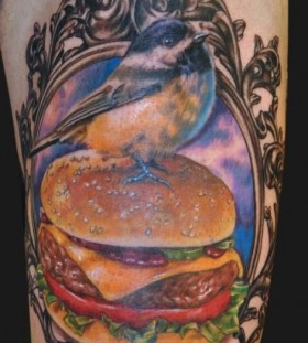 Hamburger and bird food tattoo