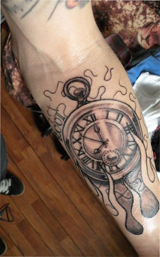 Hand clock tattoo
