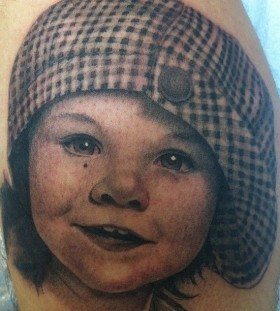 Kid tattoo by Corey Miller