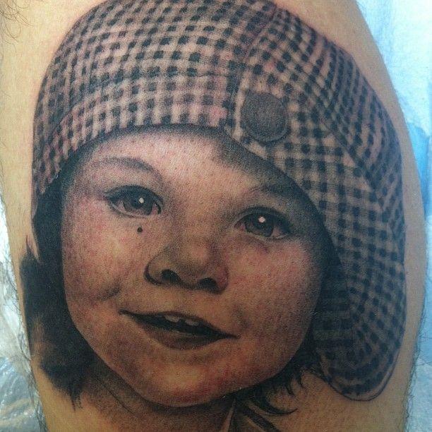 Kid tattoo by Corey Miller