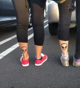 Legs alien tattoo
