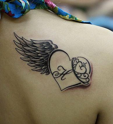Lovely heart angel wings tattoo