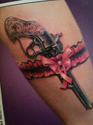 Lovely pink guns tattoo
