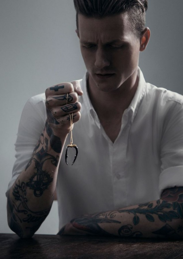 Man with tattoos and necklace