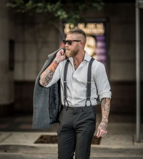 Man with tattoos in a suit