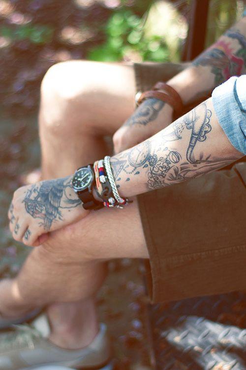 Man with tattoos sitting
