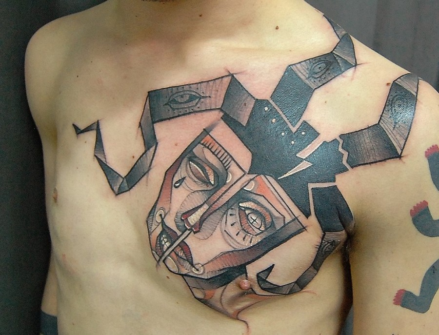 Mask on chest tattoo by Jukan