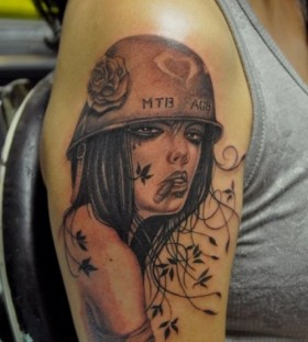 Military woman tattoo by Corey Miller